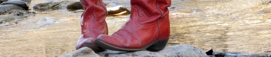 red boots on a river rock